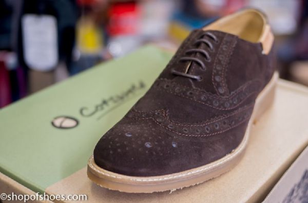 Modern deep brown suede Leather Brogue with traditional grizzled rubber sole.